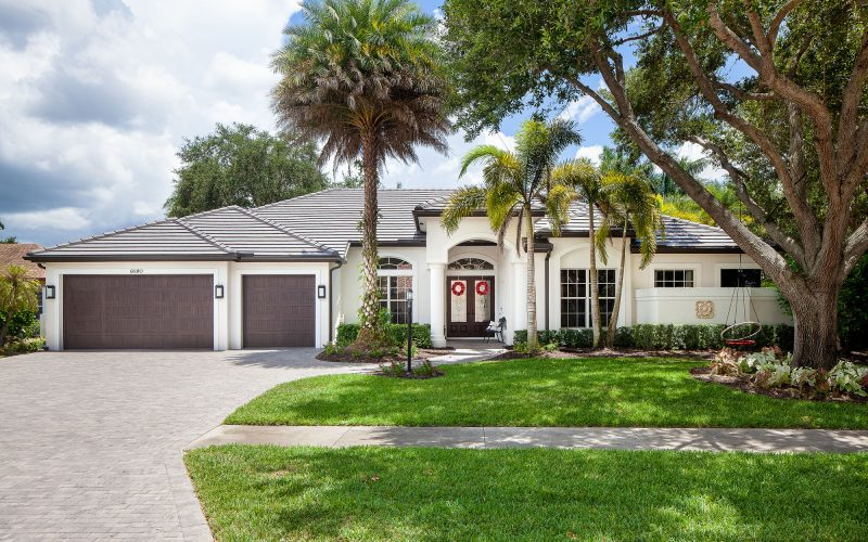 Home with Swing in the Front Yard | The Community Association for Mill Run, Collier County, Inc.