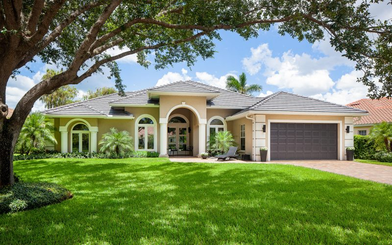 Resident Home with Large Tree | The Community Association for Mill Run, Collier County, Inc.